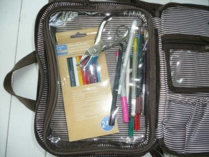 "Various pens, water color pencils, hole punch, small scissors and other tools to use for ""smashing""."