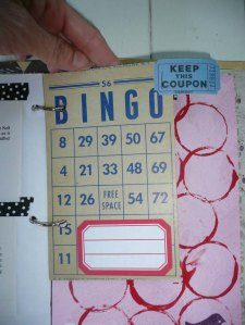 A bingo card with file tag adhered for quickie journaling.