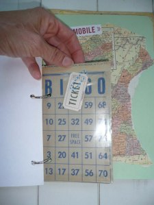 Bingo card with clear enveloped attached to stuff bits into. Also paper clip to attach stuff outside.
