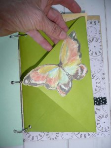 Vintage green envelope to fill with treasures. A butterfly cutout makes it pretty.
