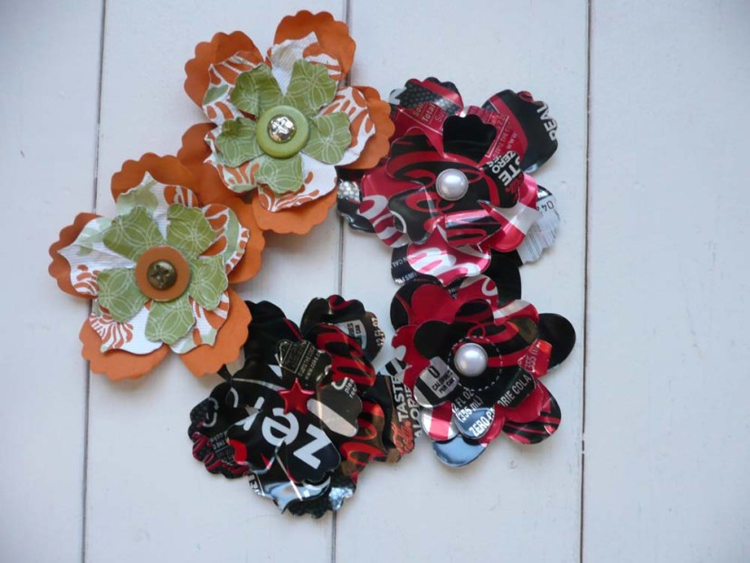 Die cut flowers from paper and soda cans!