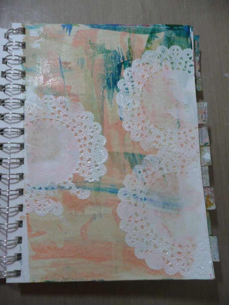 Paper doilies, one of which was mutilated when I tried to separate the stuck together pages.