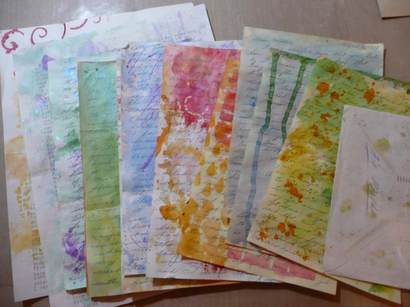 Yummy pile of shimmery water colored papers.