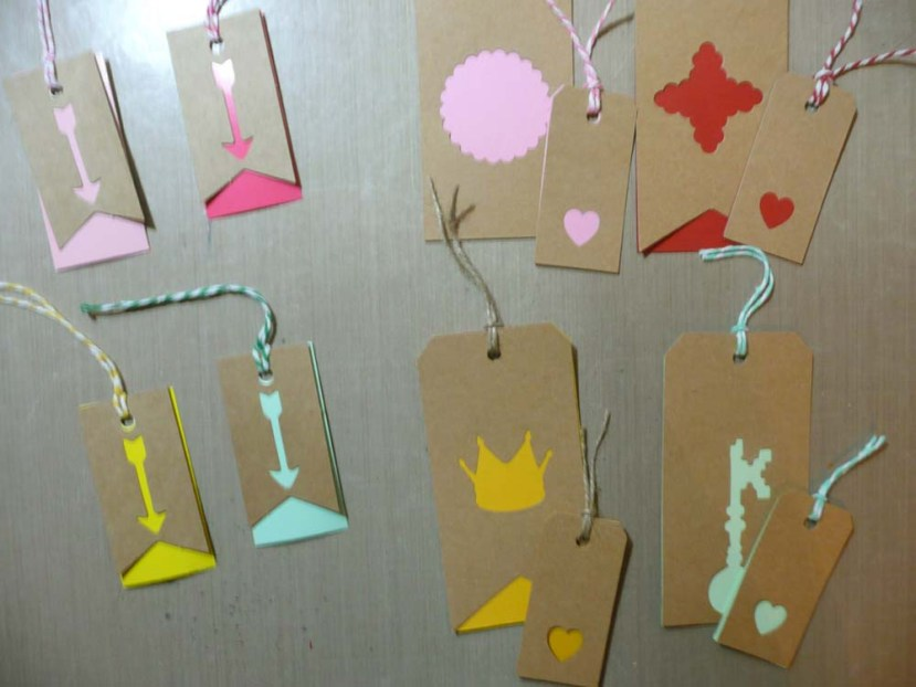 Two layered cardstock tags with mine on the right.