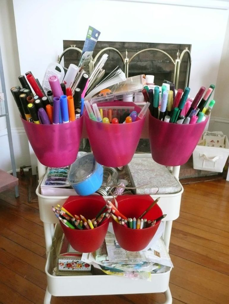 A Rascog cart from Ikea filled with paints, markers and more embellishments.